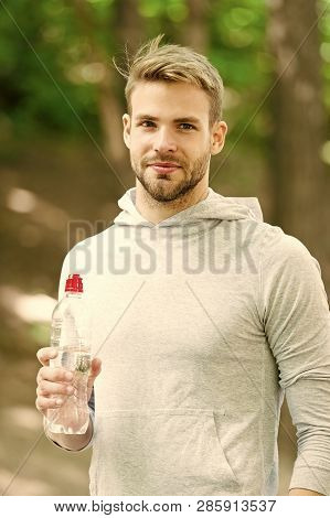 Drink some water. Man handsome jogger holds water bottle whole workout in park. Man athlete sport clothes refreshing. Sport and healthy lifestyle concept. Athlete drink water after training in park. poster