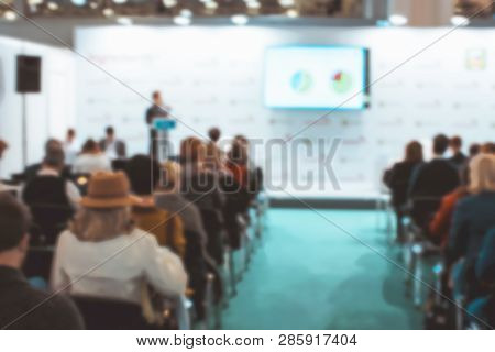 Blur Behind Student Or Collegian Study, Lecture In Classroom With Notebook And Screen Projector In B