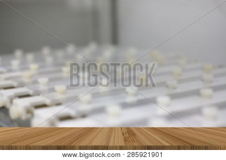 plastic electrophoresis comb & mold with agarose gel in molecular genetic lab with wood table for display product poster