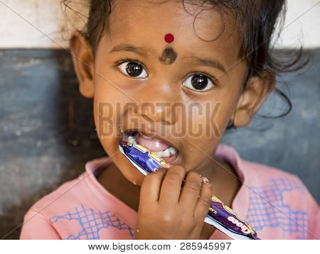 Puduchery, India - December Circa, 2018. Unidentified Poor Indian Little Girl With Shy Coy Expressio