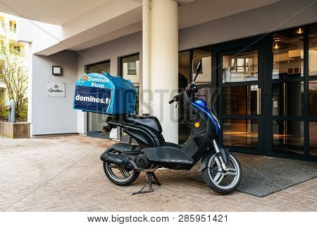 Strasbourg, France - Apr 8, 2018: Pizza Delivery Scooter Parked In Front Of The Apartment Building E
