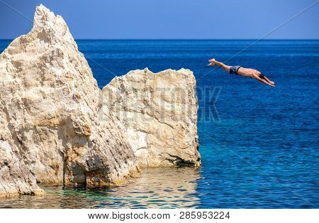 Man Jumping Into The Sea In Malta