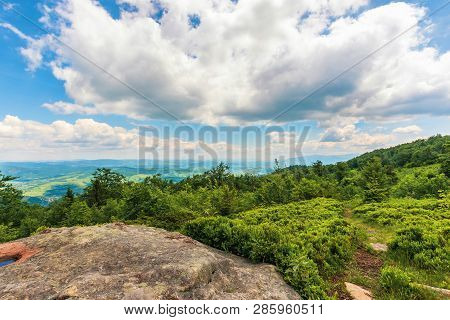 Rock On The Edge Of A Forested Hill. Beautiful Summer Landscape In Mountains. Wonderful Sunny Weathe