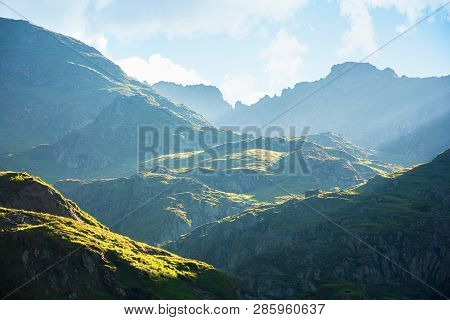 fagaras mountain ridge in the morning. rocky formations in sunlight. beautiful summer scenery