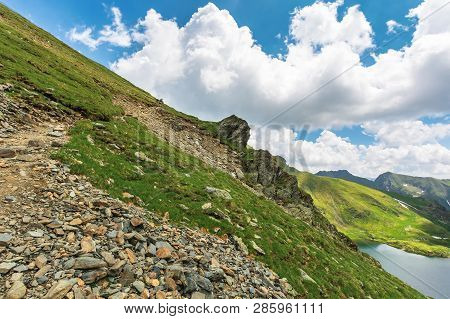 Summer Time In Romanian Carpathians. Beautiful Landscape Of Fagaras Mountains. Lake Capra Down In Th
