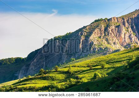 Beautiful Scenery Of Romania Mountains At Sunrise. Distant Cliff In Morning Light. Wonderful Travel