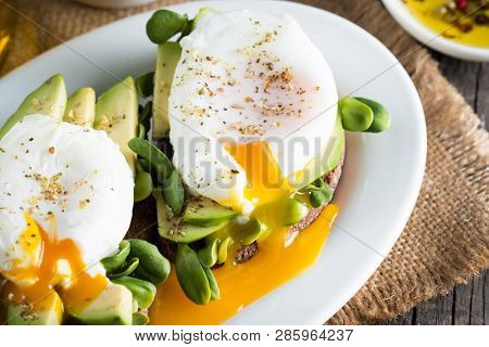 Avocado Toast, Cherry Tomato On Wooden Background. Breakfast With Toast Avocado, Vegetarian Food, He