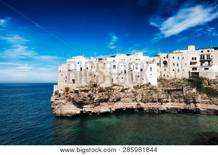 Houses In The Town Polignano A Mare Built Upon A Cliff Above The Mediterranean Sea In Puglia At The