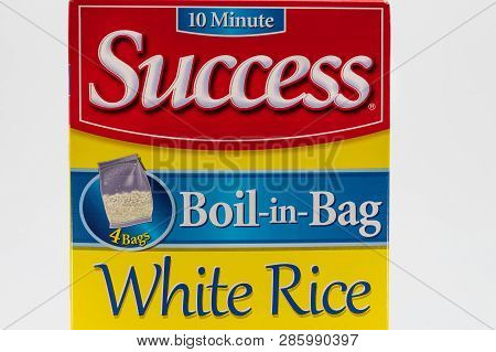 Success Rice Container And Trademark Logo