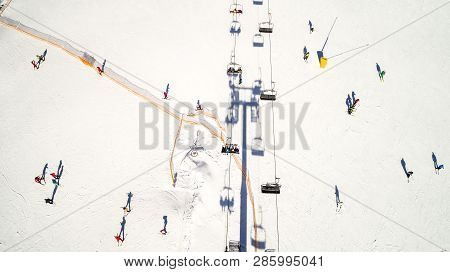 Aerial View Of The Ski Resort In Mountains At Winter. Ski Slope At Mountain Resort. Machines For Spr