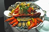 seafood platter with lobstercrab oystersmusselsprawns and more succulent seafood with garnish poster