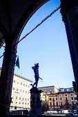 View of Loggia dei Lanzi wiht bronze statue of Perseus holding the head of Medusa  by Benvenuto Cellini in Piazza della Signoria in front of Palazzo Vecchio, Florence, Tuscany, Italy poster