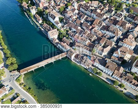 Aerial Image Of Swiss Old Town Diessenhofen With Old Wooden Covered Bridge Over The Rhine River, Can