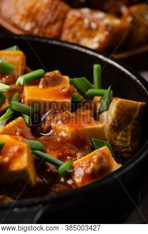 Mapo Tofu In Cast Iron Skillet With Pork Chopped Chives Soy Sauce Sichuan Pepper Garlic And Spices