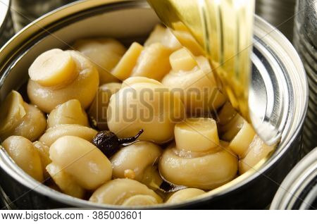 Canned Button Mushrooms In Just Opened Tin Can. Non-perishable Food