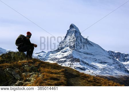 Matterhorn, Switzerland - October 16.2016: A Young Hiker Taking A Rest During Trekking With The Matt