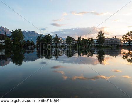 Reflection Of Swiss Town Buchs In Werdenbergersee In St. Gallen Switzerland