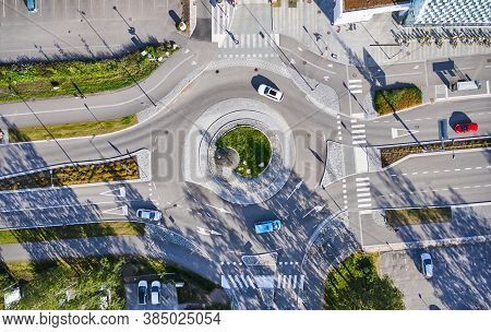 Aerial View Of The Roundabout. The Cars Moving On The Roundabout. The Modern Design Of A Street In F