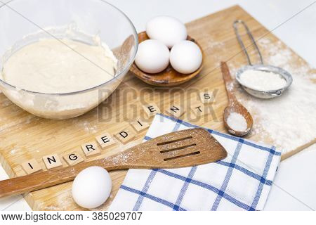 Making Dough For Bread Or Homemade Baked Goods. Ingredients On A Wooden Table. Inscription: Ingredie