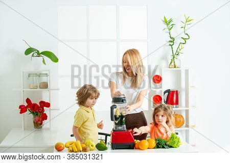 Superfood Family Concept. Happy Loving Family. Mom Daughter And Son Prepare A Smoothie In The Kitche