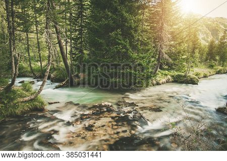 Two Crystal Clean Mountain Rivers Merge Scenery. Mont Blanc Region Italy, Europe.