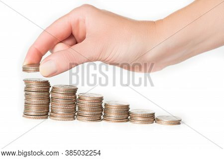 Woman Hand Stacking Us Quarters Into Increasing Columns