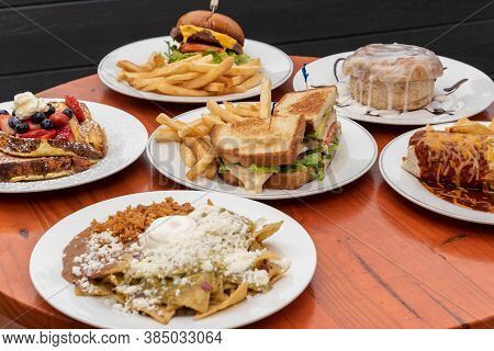 Feast Table Full Of Buffet Food To Choose From For Breakfast, Lunch, Or Dinner As A Delicious Choice