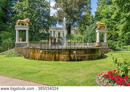 Berlin, Germany -  July 12, 2020: Lions Fountain, A Symbol For Park Glienicke, With Its Two Gilded C