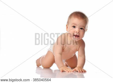 Cute Little Baby With A Smile In A Diaper, Crawling Forward To The Camera. Funny Toddler With Open M