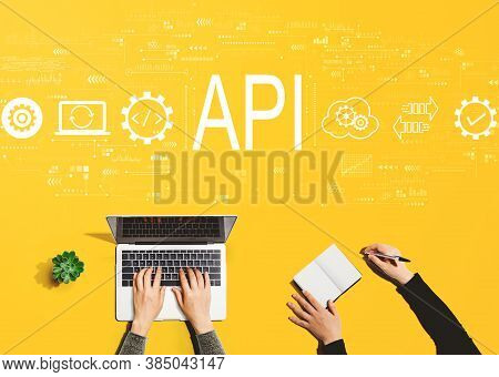 Api - Application Programming Interface Concept With People Working Together With Laptop And Noteboo