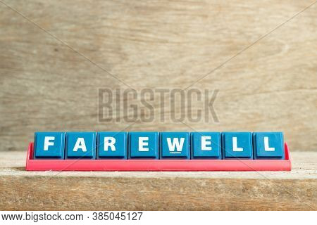 Tile Letter On Red Rack In Word Farewell On Wood Background