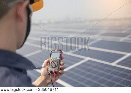 Engineer Holding  Sets The Operation Of The Solar Panel On The Roof Of The Building To Work At Full
