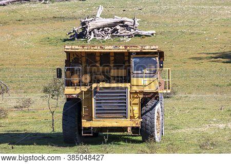 An Old Rusty Earthmoving Truck In A Green Field In Regional Australia