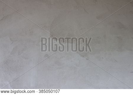 Textured Of Plastered Cement Wall Is Uneven And Still Wet For Background.