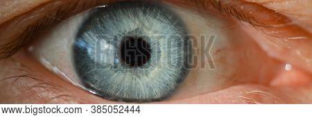 Blue Male Human Eye Retina Closeup Super Macro. Laser Correction Vision Concept
