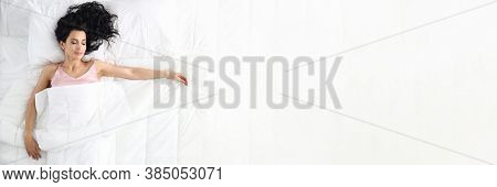 Young Caucasian Beauty Woman Sleeping On White Bed Home Portrait. Top View Background