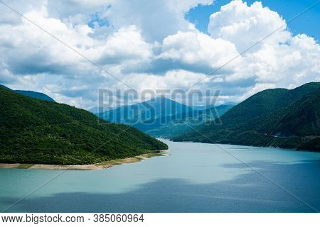 Mountain Lake With Blue Turquoise Clear Water Against The Backdrop Of A Clear Sky And Mountain Hills