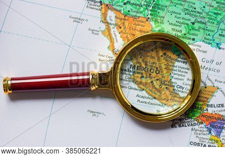 Mexico  And Other Countries  On A Map Of  South America  In A Defocused Magnifying Glass, The Theme