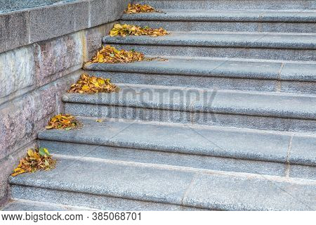 Gray Marble Or Granite Stone Urban Stairway With Yellow Fallen Foliage In Corner Of Every Stair. Aut