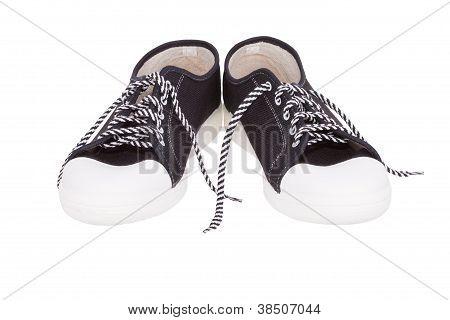 pair of simple gumshoes ( sneakers )