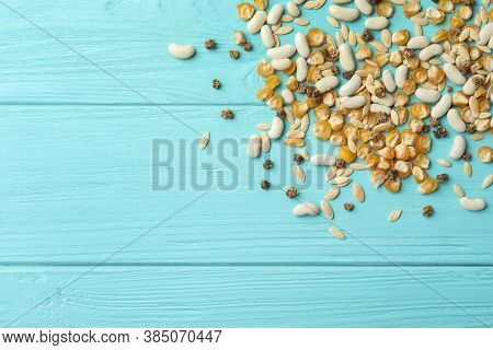 Mixed Vegetable Seeds On Light Blue Wooden Background, Flat Lay. Space For Text