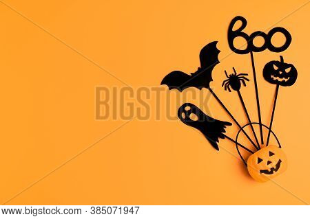 Halloween Background. Top View Halloween Party Accessories And Jack-o-lantern Pumpkin On Orange Back