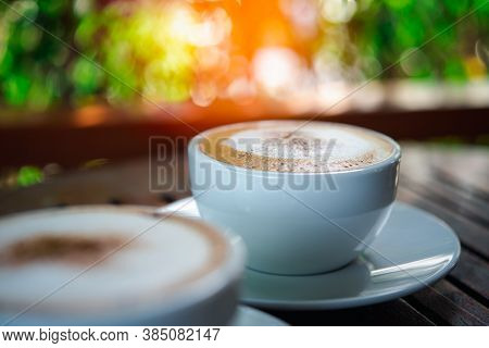 Coffee In White Cup On Table At Coffee Shop