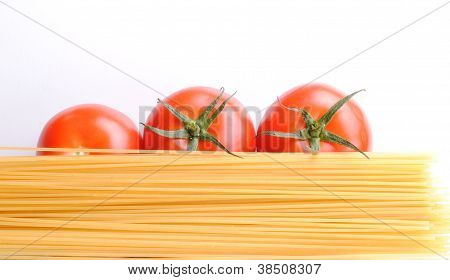 raw spaghetti and tomatoes soft shadows