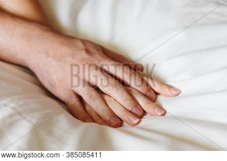Woman And Man Hands Concept. Sexy Couple Close Up. Hands Of Couple Lovers Having Sex On A Bed.