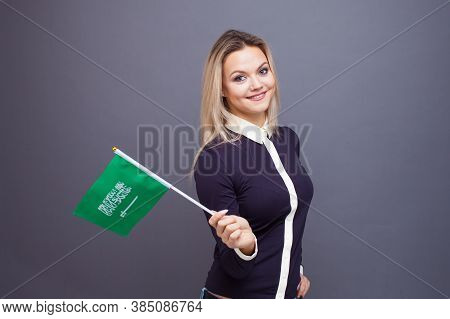 Immigration And The Study Of Foreign Languages, Concept. A Young Smiling Woman With A Saudi Arabia F