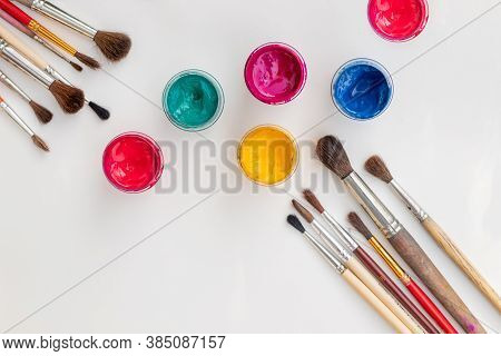 Open Gouache Jars On White Background, Flat Lay Composition, Top View.copy Space.flat Lay Compositio