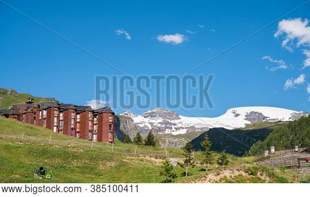 Alpine Style Condominium With Wooden Facade Surrounded With Ski Resort And Mountain Views.