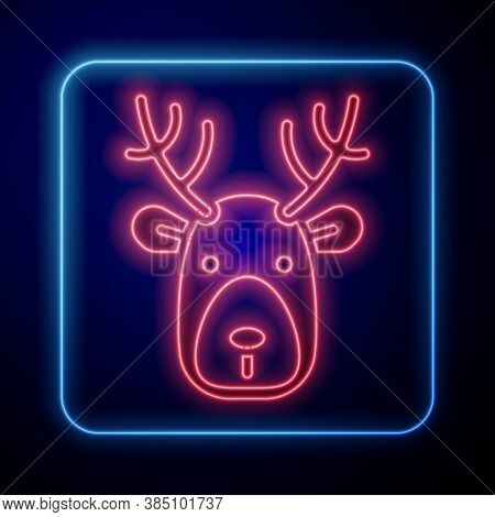 Glowing Neon Deer Head With Antlers Icon Isolated On Blue Background. Vector
