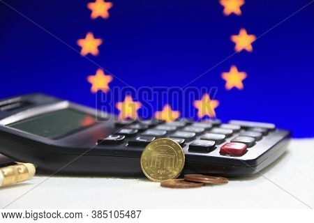 Ten Germany Euro Cent On Obverse And Two Coin Of Two Euro Cent On White Floor With Black Calculator